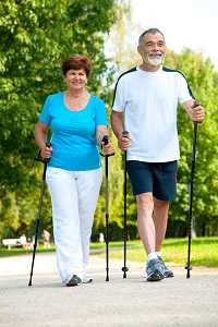 Senior couple making nordic walking